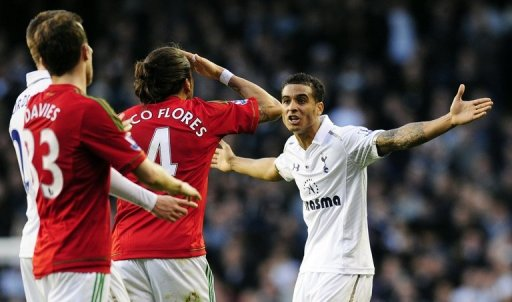 Tottenham defender Kyle Naughton (R) argues with Swansea defender Chico Flores at White Hart Lane on December 16, 2012