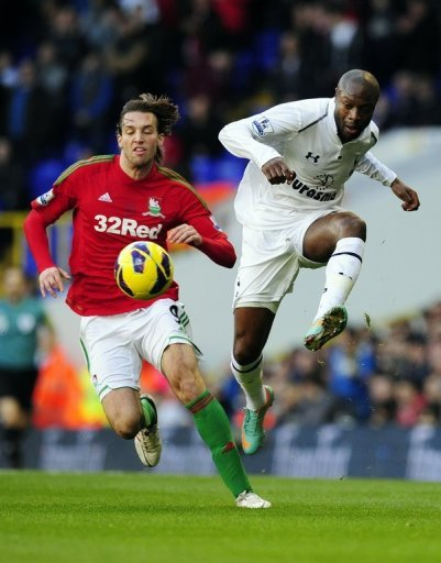 Tottenham defender William Gallas clears the ball from Swansea forward Michu at White Hart Lane on December 16, 2012