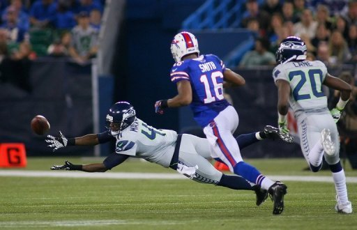 Byron Maxwell of the Seattle Seahawks fails to reach a pass for an interception on December 16, 2012 in Toronto, Canada