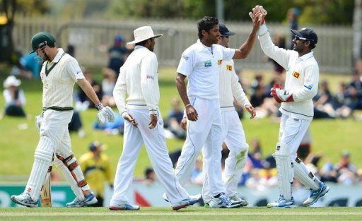 Chanaka Welegedara (3rd R) celebrates after dismissing Ed Cowan (L) at the first Hobart Test on December 17, 2012