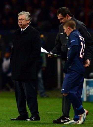 Paris Saint-Germain's coach Carlo Ancelotti (left) on December 4, 2012 at the Parc des Princes stadium in Paris