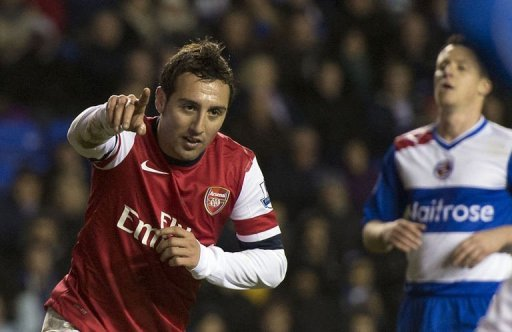 Arsenal's Spanish midfielder Santi Cazorla (R) celebrates scoring his third goal against Reading