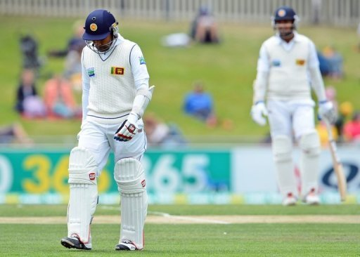 Mahela Jayawardene (L) walks off after being dismissed on the final day of the first Test in Hobart on December 18, 2012