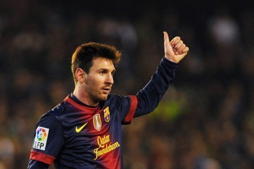 Lionel Messi gives the thumbs up during his side's match against Real Betis in Seville on December 9, 2012
