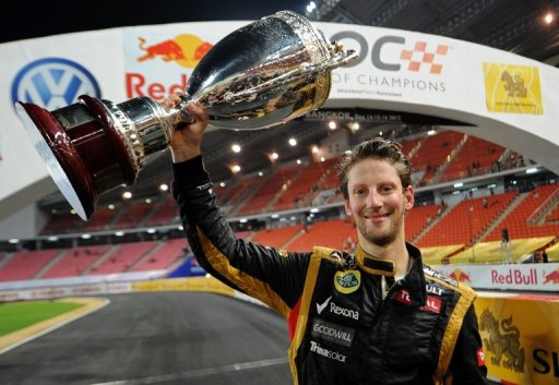 French F1 driver Romain Grosjean celebrates with the trophy after winning the Race of Champions on December 16, 2012