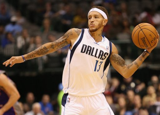 Delonte West of the Dallas Mavericks passes the ball against the Phoenix Suns during a preseason game on October 17, 2012