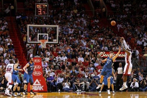 LeBron James of the Miami Heat shoots over Andrei Kirilenko of the Minnesota Timberwolves on December 18, 2012