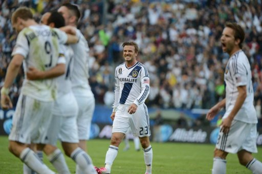 David Beckham and other members of the Los Angeles Galaxy celebrate a goal on December 1, 2012
