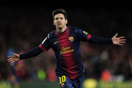 Barcelona forward Lionel Messi celebrates after scoring against Atletico de Madrid on December 16