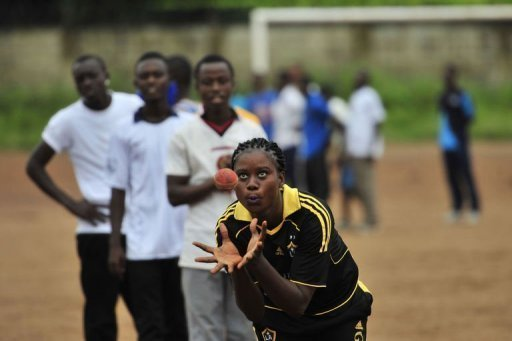 People play cricket at Kingtom Oval, Sierra Leone's only cricket ground, on November 15, 2012