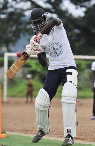 A man plays cricket at Kingtom Oval in Freetown, Sierra Leone's only cricket ground, on November 15, 2012