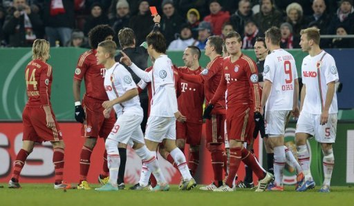 The referee shows the red card to Bayern Munich's Franck Ribery during a match against FC Augsburg on December 18, 2012