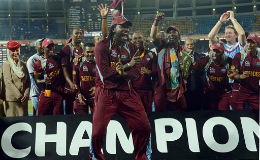 West Indies cricketer Chris Gayle (C) celebrates his team's victory in Colombo on October 7, 2012