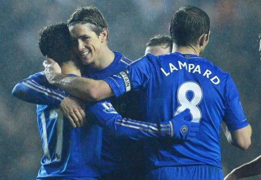 Fernando Torres (2nd left) hugs Eden Hazard as Chelsea score their 5th against Leeds at Elland Road on December 19, 2012