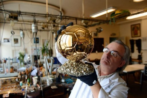 Artisan Michel Garault works on the Ballon d'Or 2012 at the Mellerio jewelery workshops in Paris on December 6, 2012