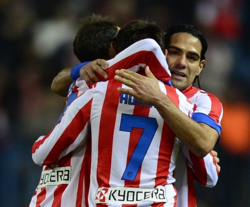 Atletico Madrid players celebrate their 1-0 victory over Celta de Vigo, in Madrid, on December 21, 2012
