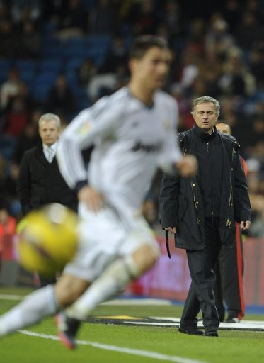 Real Madrid's coach Jose Mourinho (R), pictured during their match against Espanyol, in Madrid, on December 16, 2012