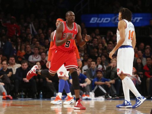 Luol Deng of the Chicago Bulls celebrates after hitting a shot against the New York Knicks on December 21, 2012
