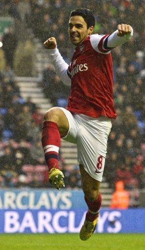 Arsenal's Spanish midfielder Mikel Arteta celebrates scoring the opening goal  December 22, 2012.