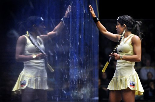 Nicol David of Malaysia (R) is reflected in the glass during a tournament on August 19, 2012 in Canberra