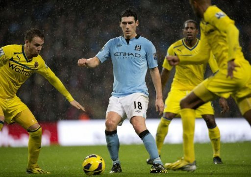 Manchester City's midfielder Gareth Barry fights for the ball in Manchester on December 22, 2012