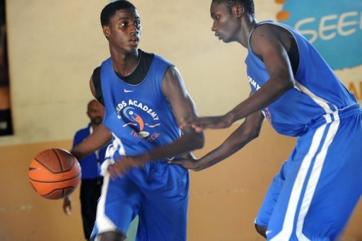 Adoulaye Lamb Diallo (L), a student at Seeds Academy, trains at the free basketball-focused boarding school in Senegal