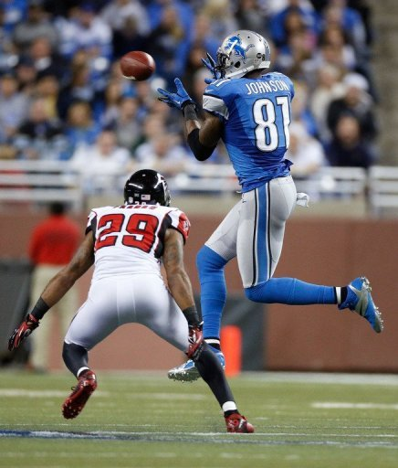 The Detroit Lions' Calvin Johnson (R) and Dominique Franks of the Atlanta Falcons during their game on December 22, 2012