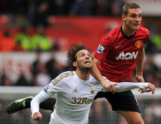 Manchester United's Nemanja Vidic vies with Swansea's Miguel Michu (left) Swansea, South Wales,  December 23, 2012