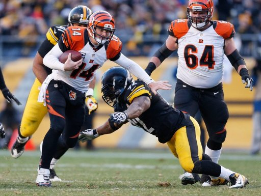 Andy Dalton of the Bengals tries to get around the tackle of James Harrison of the Steelers on December 23, 2012