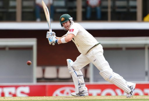 Michael Clarke steers the ball away from the Sri Lankan bowling in Hobart, on December 17, 2012