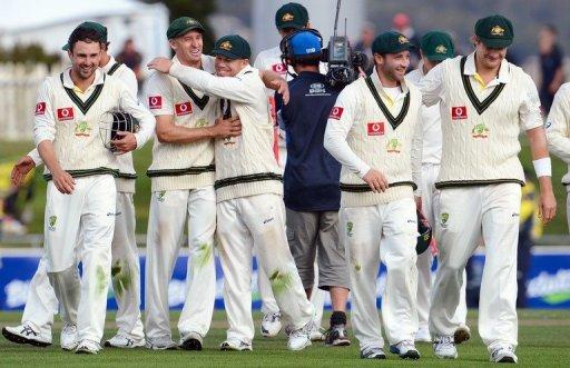 Australian team celebrate after bowling Sri Lanka out, in Hobart, on December 18, 2012