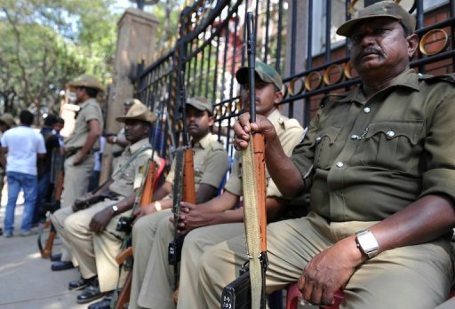 Armed Indian police on guard at the main gate of the M. Chinnaswamy Stadium in Bangalore on December 25, 2012