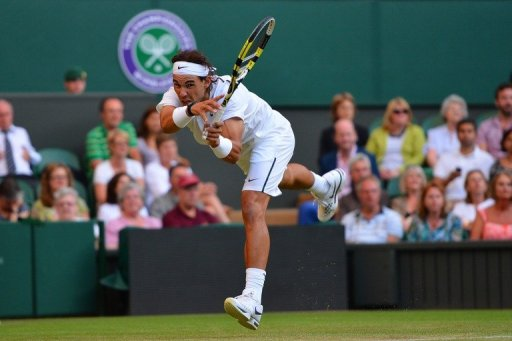 Spain's Rafael Nadal plays a shot against Czech Republic's Lukas Rosol at Wimbledon on June 28, 2012