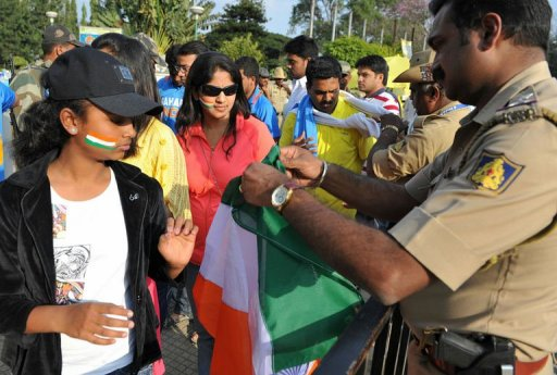 Cricket fans undergo security checks in Bangalore on December 25, 2012