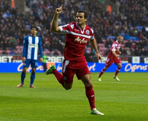 Queens Park Rangers' defender Ryan Nelsen celebrates after scoring a goal in Wigan on December 8, 2012