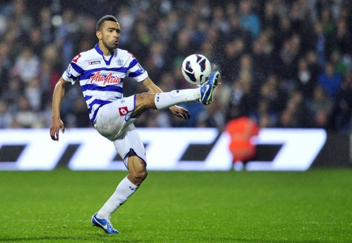 Queens Park Rangers' defender Jose Bosingwa clears the ball in London on October 21, 2012