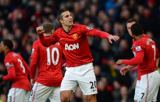 Robin van Persie celebrates scoring the first goal against Sunderland at Old Trafford on December 15, 2012