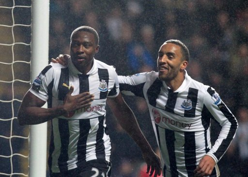 Shola Ameobi (L) celebrates scoring the winning goal for Newcastle against QPR on December 22, 2012