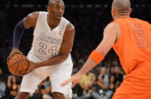 Kobe Bryant of the Los Angeles Lakers (L) is guarded by Jason Kidd of the New York Knicks on December 25, 2012