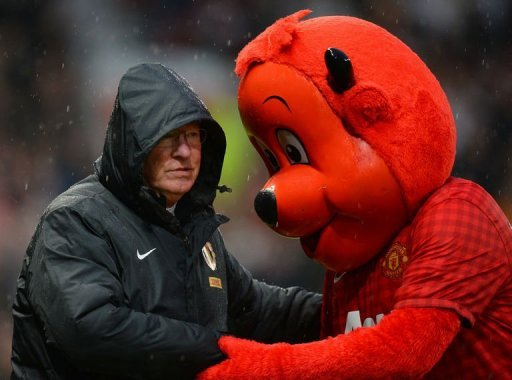 Manchester United manager Alex Ferguson shakes hands with Fred the Red at Old Trafford on December 26, 2012