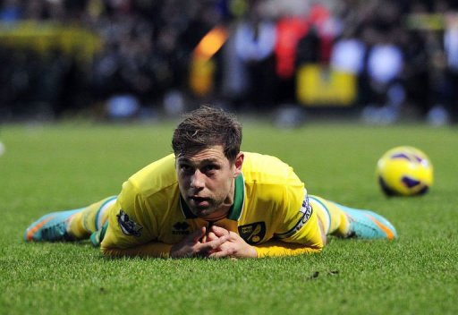 Norwich City's Grant Holt reacts after being tackled by Chelsea's David Luiz in Norwich on December 26, 2012