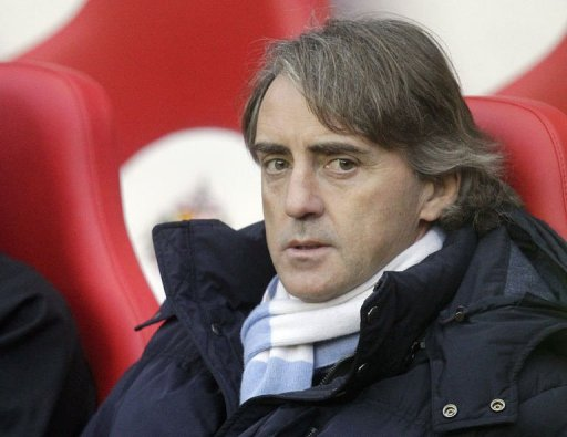 Manchester City manager Roberto Mancini takes his seat at The Stadium of Light in Sunderland on December 26, 2012