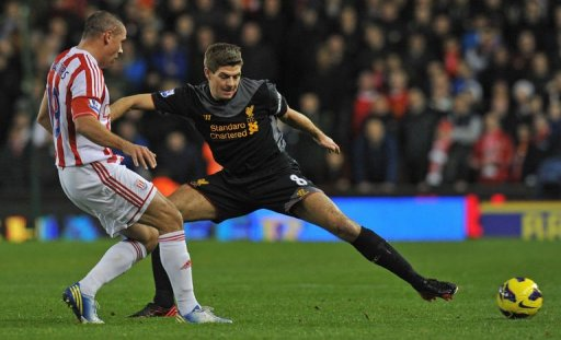 Liverpool's Steven Gerrard (R) vies with Stoke City's Jonathan Walters (L) in Stoke-on-Trent on December 26, 2012