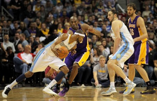 Corey Brewer of the Denver Nuggets slips past Kobe Bryant of the Los Angeles Lakers at Pepsi Center on December 26, 2012