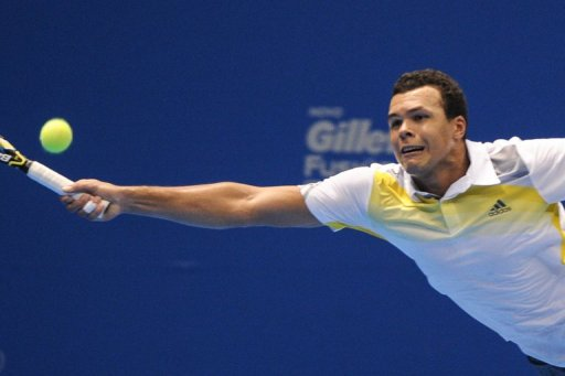 Jo-Wilfried Tsonga returns a shot against Roger Federer during an exhibition match in Sao Paulo on December 8, 2012