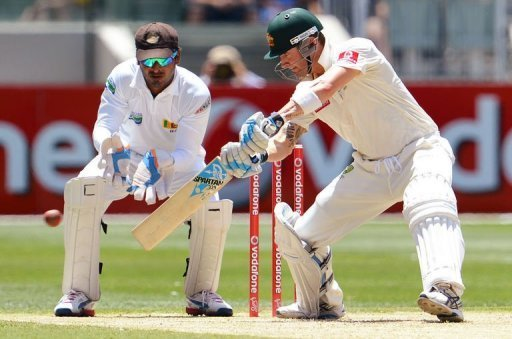 Michael Clarke cuts a ball on the way to scoring his century on the second day of the second Test on December 27, 2012