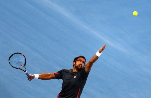 Serbia's Janko Tipsarevic serves to Britain's Andy Murray in the Emirati capital Abu Dhabi on December 27, 2012