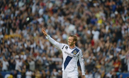 David Beckham waves to fans as he walks off the pitch on December 1, 2012 in Carson, California
