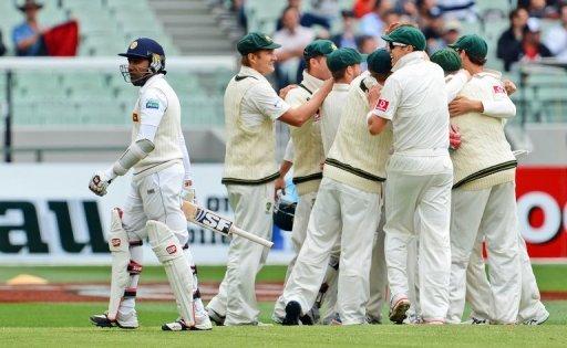 Sri Lanka's batsman Mahela Jayawardene walks off after been dismissed by Australia, in Melbourne, on December 28, 2012