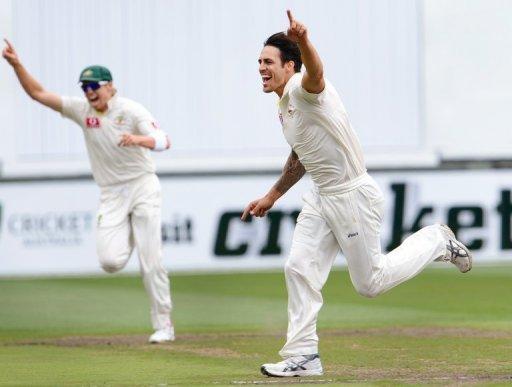 Australia's Mitchell Johnson (R) celebrates after dismissing Sri Lanka's Tillakaratne Dilshan, on December 28, 2012